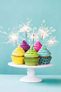 36056523 - colorful cupcakes decorated with sparklers